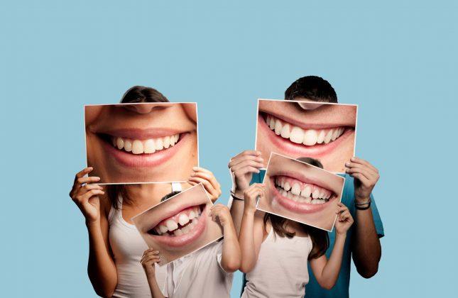 people-holding-teeth-photos